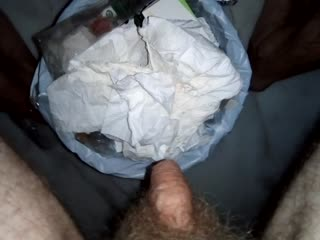 John is waking up and Pissing into the Trashcan